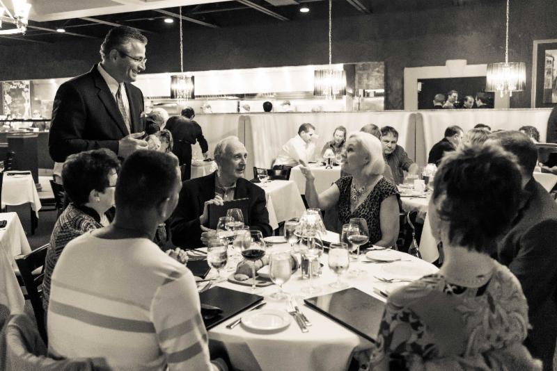 Tony- at a table